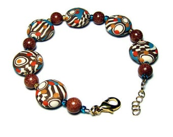 50% OFF SALE Op Art Canework Lentil Bead Polymer Clay Bracelet Jewelry Handmade Art Jewelry Goldstone Seed Beads Copper Orange Lobster Clasp