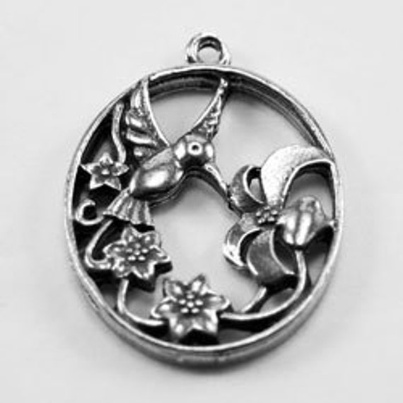 Oval with  Humming Bird and  Flowers - 1 Bail Australian pewter pendant B66