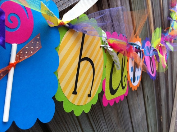 HAPPY BIRTHDAY banner in bright funky colors with Lollipops and Black Letters