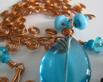 MARISSA. Copper Scrollwork links with Sky Blue g;ass. Necklace. one of a kind