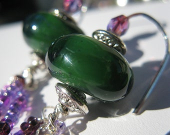 EMERALD NIGHTS. green and purple artisan lampwork glass and sterling silver earrings