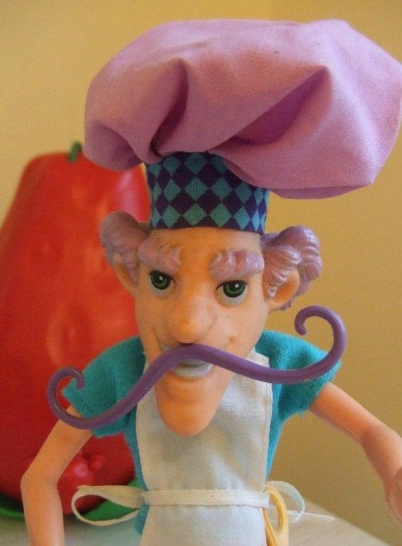 Vintage STRAWBERRY SHORTCAKE Villain PURPLE PIE MAN doll with pet apron and baking spoon