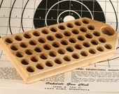 Maple reloading block with deep holes for .45-70