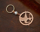 Hunger Games Inspired Mockingjay Keychain with Peeta's Pearl, Unofficial Memorabilia
