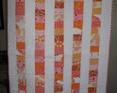 Dreamsicle Baby Girl stacked coin quilt in pinks and oranges