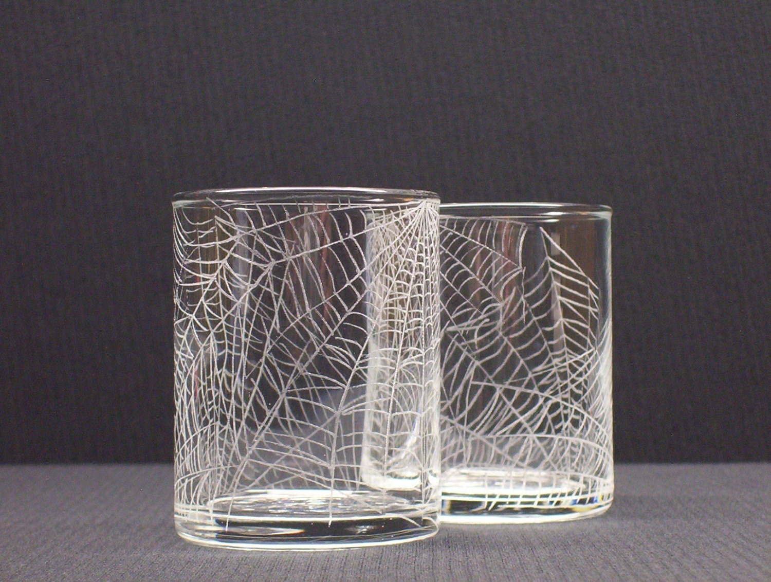 webs 2 hand engraved glass candle holders featured on