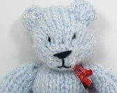 Charli the knitted teddy bear