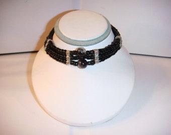Black Onyx tri cord bracelet with large crystal glass