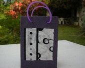Small handcrafted gift bag with fabric decoration amde from recycled paper, lilac black and white