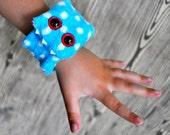 Whipper Slapper - a furry monster slap bracelet in blue polka dot