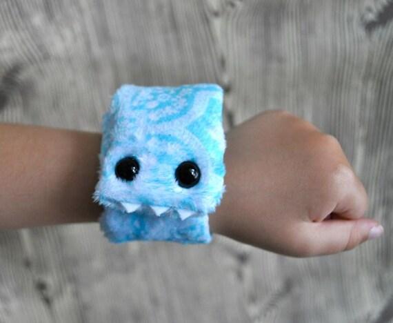Whipper Slapper - a furry monster slap bracelet in pretty blue and white