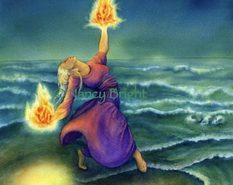 Barefoot woman in purple dress by the ocean at night holding fire in her hands