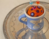 Needle felted pin cushion in a vintage ceramic childrens cup
