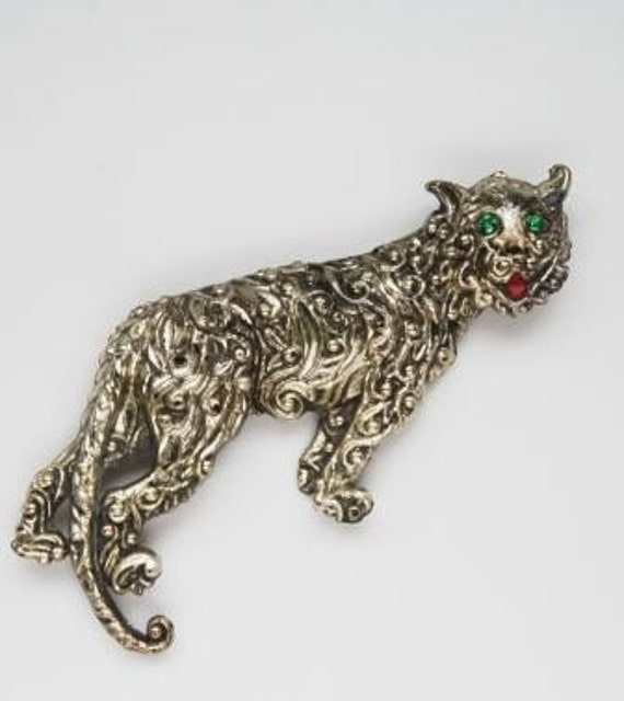 Vintage Cat Brooch Figural Jaguar with Green Rhinestone Eyes scrollwork metal tin offered by Tootsystreasures on Etsy