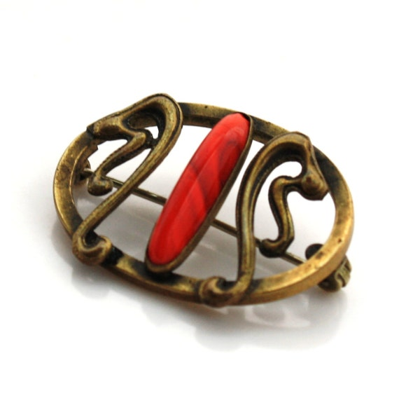 Victorian Brooch Red Stone with Antique Gold toned metal scrollwork vintage offered by TJsVintageTreasures
