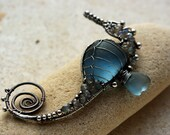 BLUE-GRAY seahorse wire wrapped seaglass pendant.