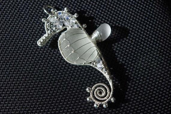 Pure WHITE seahorse wire wrapped seaglass pendant.