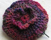 Round coin purse with flower, zipper closure, hand crocheted and fully lined, purple-orange-red medley, 4.25""