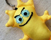 Soft keychain, whimsical creature with evil grin - makes great stocking stuffer, bright canary yellow