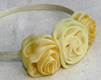 Fabric rose headband, in shades of creamy yellow, child size