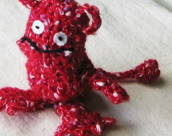 Red monster, crocheted from soft speckled red yarn, a little over 5 inches tall