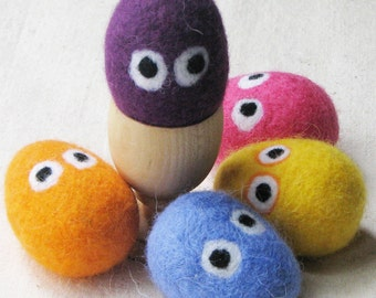Easter eggs with googly eyes - felted from colorful wool for Easter decorating and gift giving