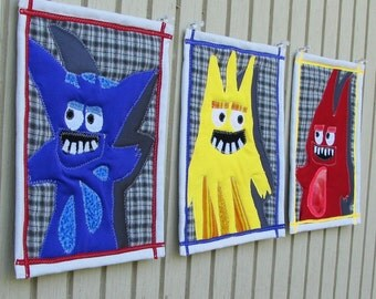 Wall art for kids room: 3 small art quilts with whimsical monsters in primary colors, one of a kind fabric collage