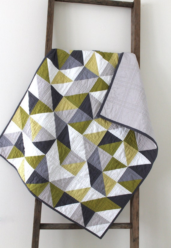 a modern geometric baby quilt.