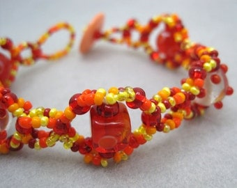 Beaded Bracelet - Dotted Red Orange Yellow by randomcreative on Etsy