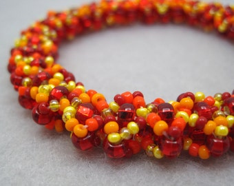 Beaded Bangle Bracelet - Warmth (red, orange, yellow) by randomcreative on Etsy