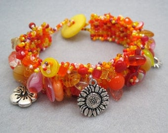 Beaded Cuff Bracelet - Orange Yellow Red Pink Summer Vivid Bright by randomcreative on Etsy