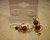 Spiral thread through the ear Earring Lake Superior Agate Beads