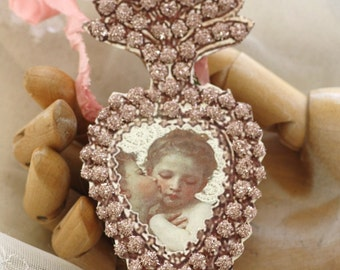 the kiss - a pink ex-voto paper locket