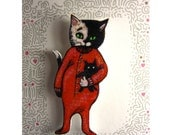 Black and White Cat in Red PJs Pin