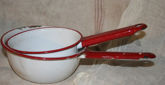 Two Nesting Red and White Enamelware Pots