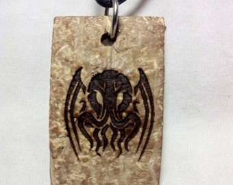 Tribal Cthulhu design on coconut shell pendant