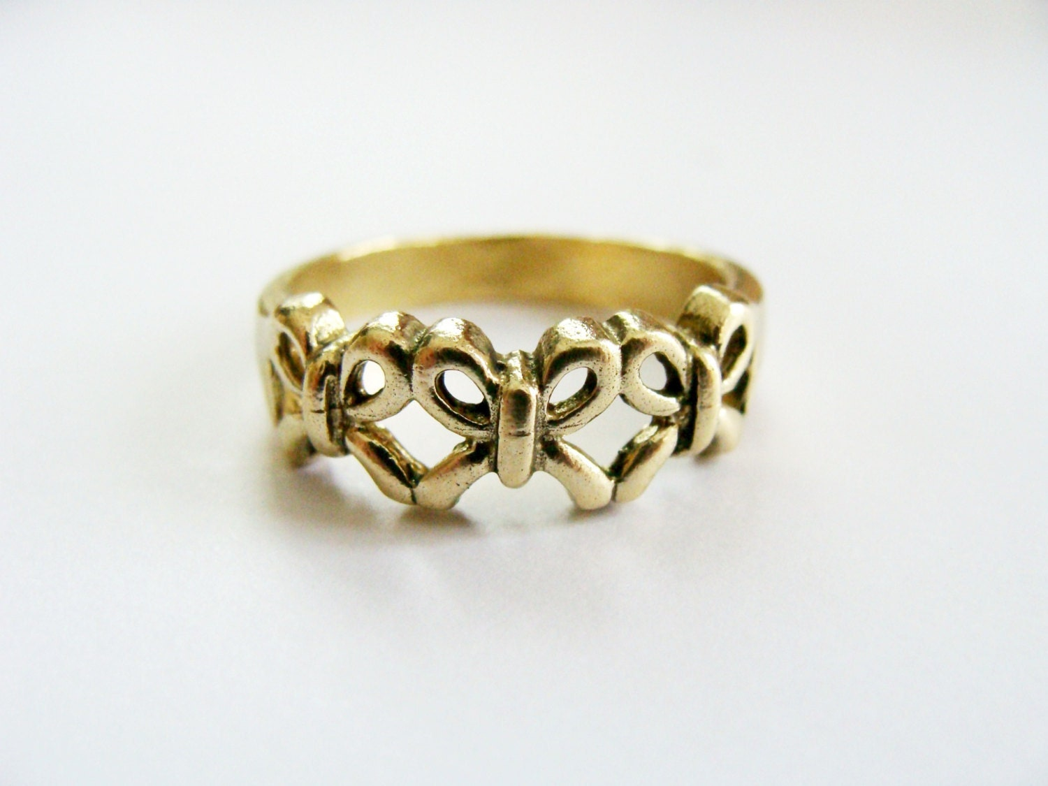 bow ring gold metalwork solid brass ring gold bow stack