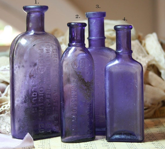 Violet shaded Antique Glass Bottles with Writing