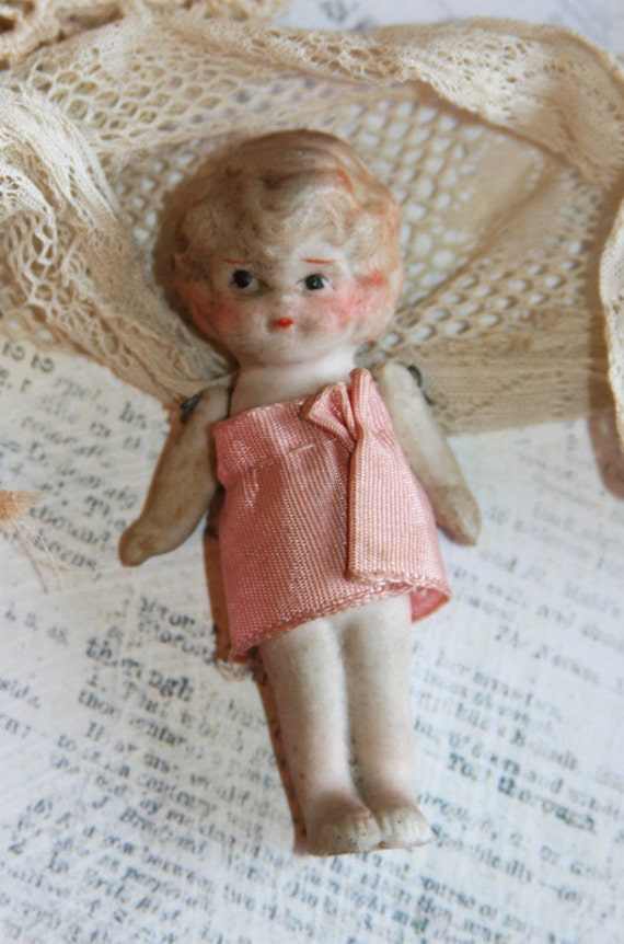 Porcelain Jointed Kewpie Doll with Hand painted face