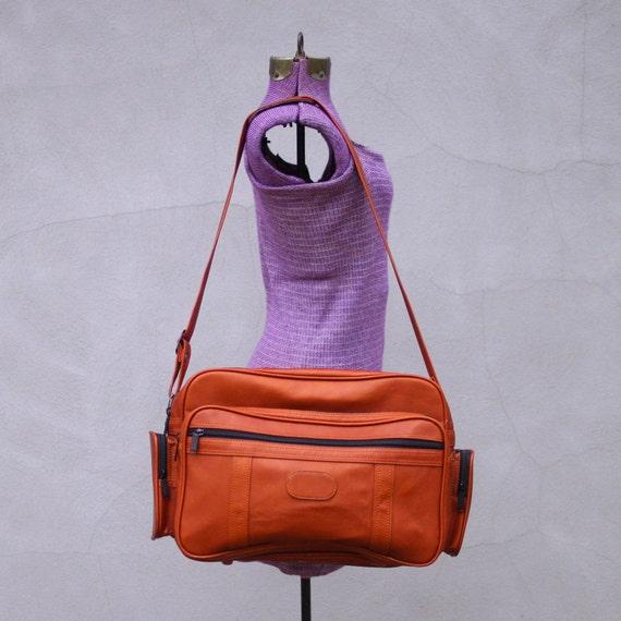vintage burnt SIENNA travel bag.