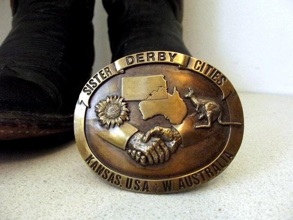Vintage 1985 Derby Kansas and Australia Sister Cities limited edition belt buckle with sunflower and kangaroo