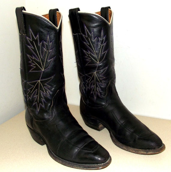 Black leather Nocona cowboy boots with white and purple stitched design