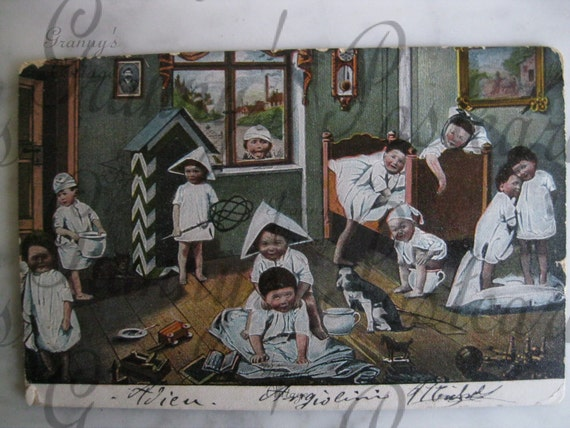 Original Antique French postcard. Multiple babiesWith Toys and Dog. Collectors item. You must see. Early 1900