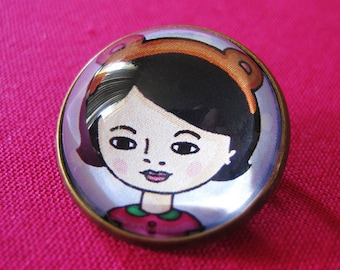 Bear Mo Glass Brooch - Round bronze brooch with girl in teddy ears headband