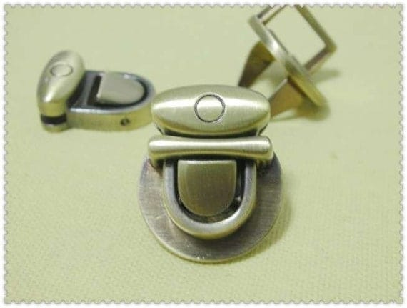 24mm( about 1 inch) x21mm  Thumb Catch ( tongue clasp) anti brass brushed E56