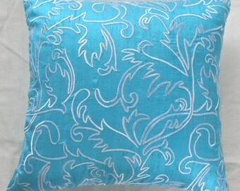 turquoise blue pillow with white moroccan/marakesh inspired white embroidery
