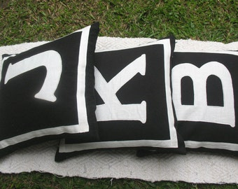 monogrammed pillows in stock letters  K-18 inches - black and white only