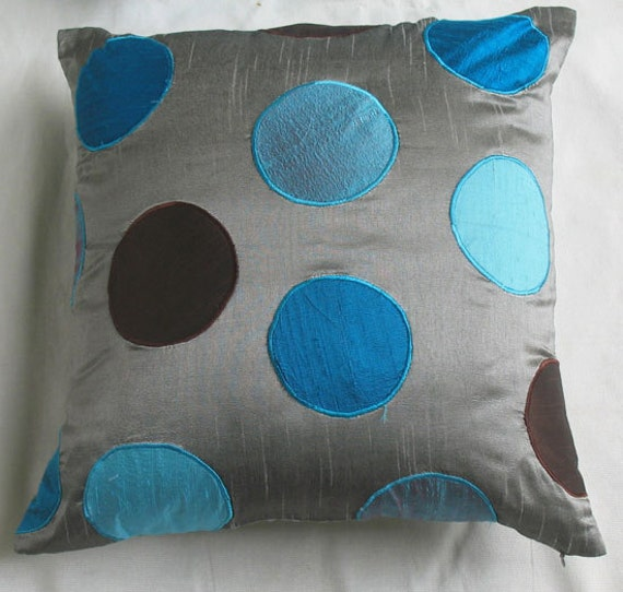 gray throw pillow cover with circles appliqued in different shades of blue and brown. silver  art  silk pillai. can be  customized. 20inch