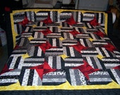 Black and White Quilt with Red Stars