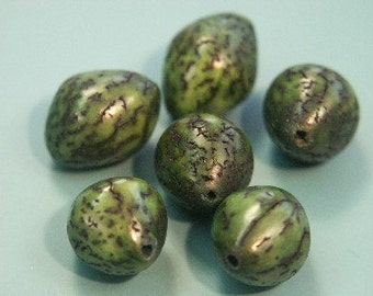 Lot of 14 rare vintage 1970s oval dyed green natural organic betelnut beads from the philliphines for your beading prodjects